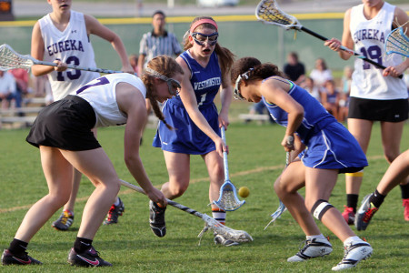 Megan+Sutton%2C+JV+attack+beats+her+Westminister+opponenets+to+the+ball%2C+April%2C+9.