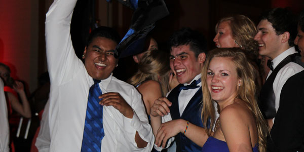 Shaan Muthukumaru, Cole Estrada and Kaily Gustafson (12) enjoy a dance and a laugh at Prom, April 6.