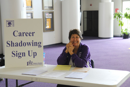 Mrs. Jo Ann Beck, P.I.E. coordinator, waits to help students sign up for Career Shadowing, Aug. 27.