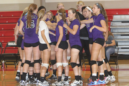 The+Girls+Varsity+Volleyball+team+huddle+during+their+game+against+Ursuline+at+Ursuline%2C+Sept.+9.