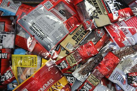 A small portion of the dozens of boxes of jerky in Coach Schneider's room, Sept. 30.