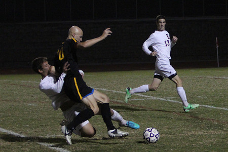 Nick Hoeflinger and Mitch Chambliss show a lot of effort against Vianney, Oct. 10.