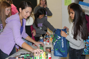 Audrey Dames, StuCo member, counts the items brought in by Pushti