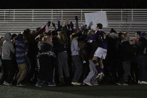The Wildcats celebrate with their fans after defeating Vianney in penalty kicks, Nov. 12.
