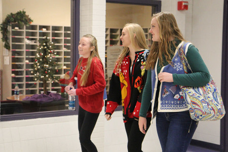 Gabbie+Stevens+%2810%29%2C+Kaitlyn+Roberts+%2811%29+and+Alexandra+Jackson+%2811%29+stroll+through+the+halls+sporting+their+festive+sweaters%2C+Dec.+13.