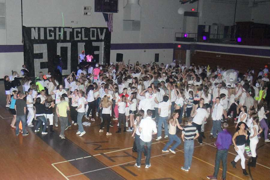 Students huddle in Gym B dancing at the first ever NightGlow, Jan. 25, 2013.
