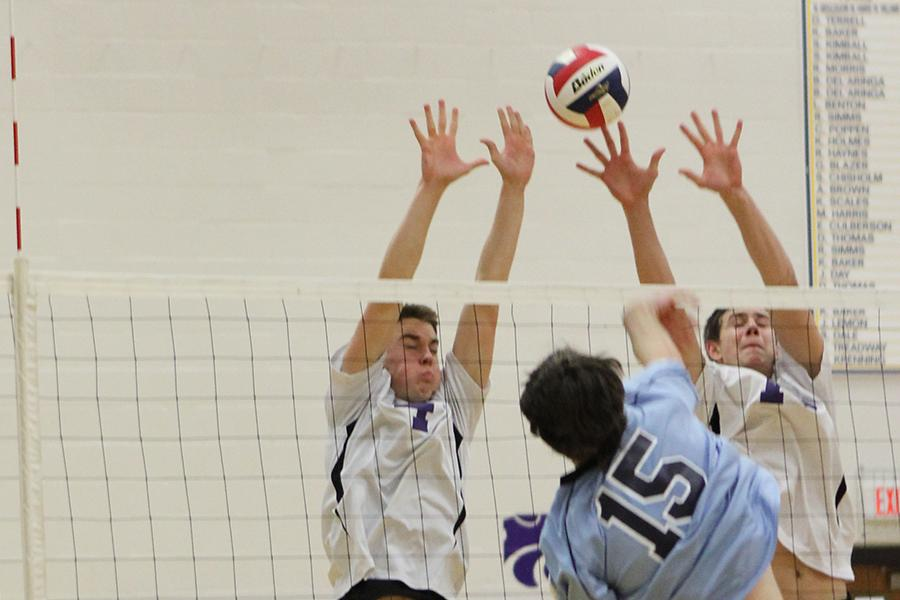 John Jameson, hitter, and Forrest Nettles, hitter, go up for a block against Parkway West, Apr. 1.
