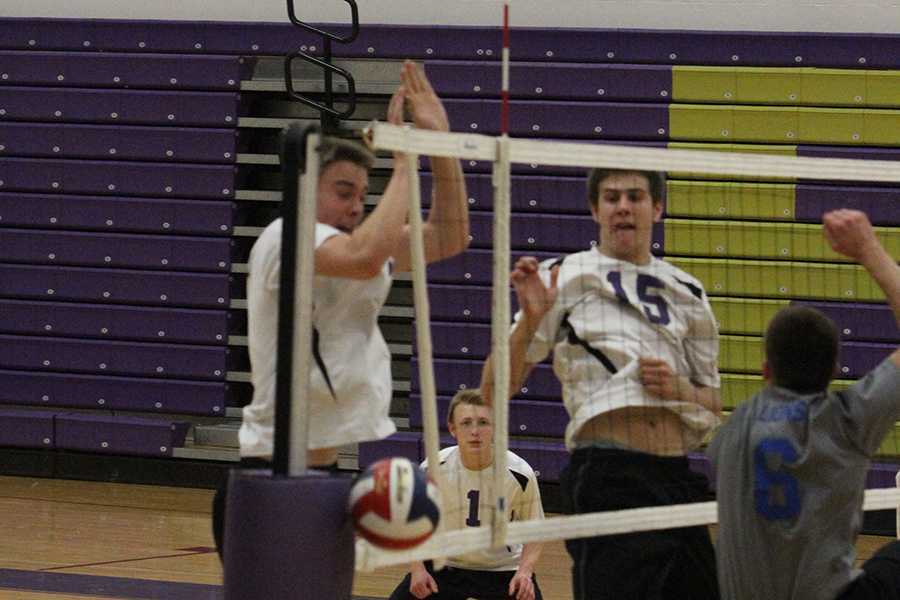 John Jameson, hitter, and Forrest Nettles, hitter, land after their block attempt during the game against Northwest, April 15.