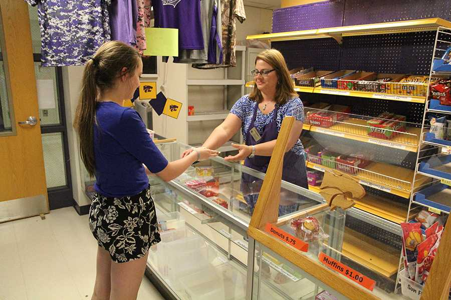 Kaitlyn Puyear (9) purchases candy from Mrs. Laurie Forsythe in the school store, May 6. This option will not be available next year thanks to the Hunger-Free, Healthy Kids Act of 2010.