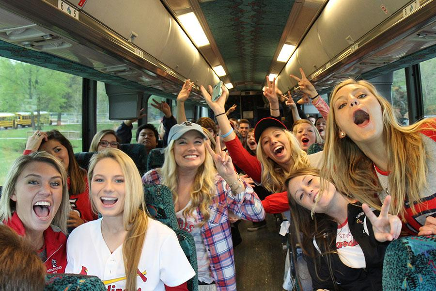 Seniors%2C+decked+out+in+their+Cardinals+gear%2C+head+to+Busch+Stadium+on+charter+buses%2C+April+30.