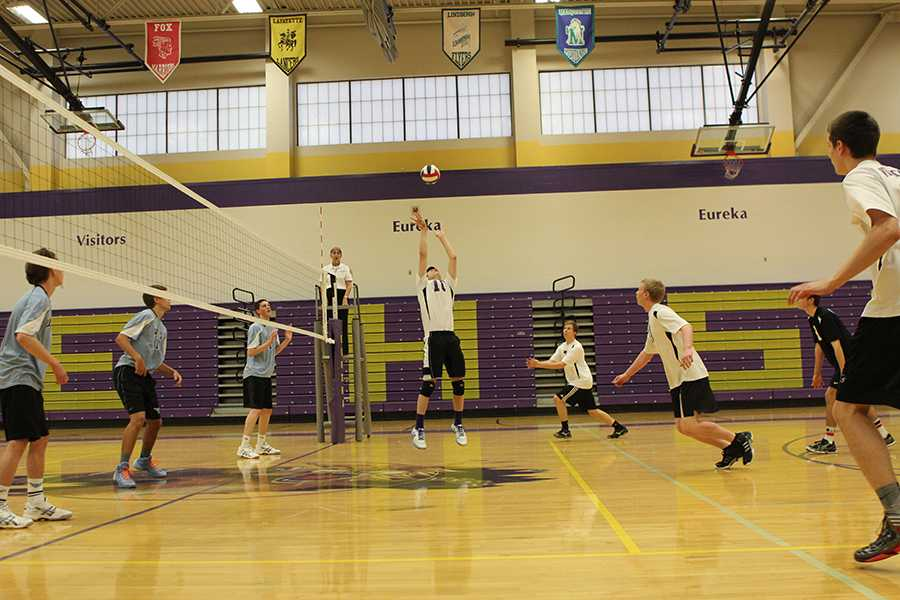 Ethan Mourer (setter) sets the ball in the air against Parkway West on April 1.