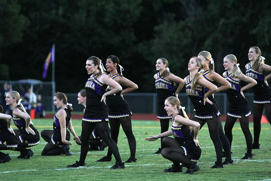 Natalie+Timm+%2812%29+performs+with+the+Golden+Line+team+during+their+halftime+performance+at+the+varsity+football+game+against+Hazelwood+Central%2C+Sept.+6
