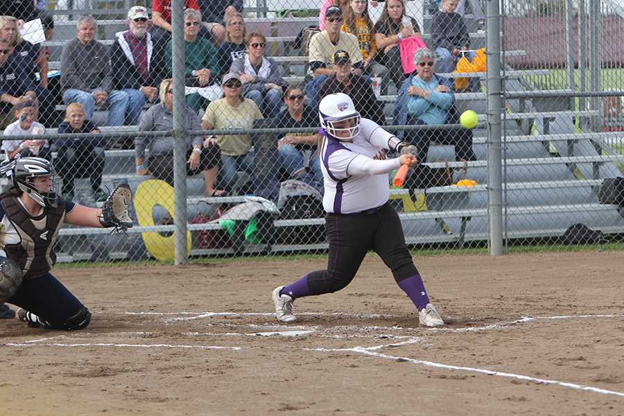 Katelyn Massa, catcher, shoots the ball to left field, Oct. 24.
