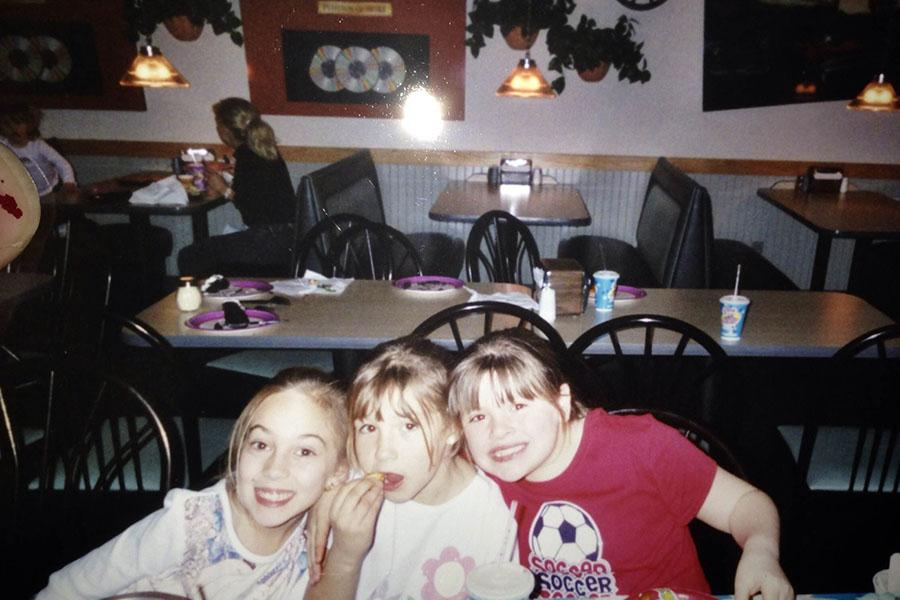 I love how I am shoving my face with food during a picture. To my left is my childhood best friend Carissa Bacandreas and to my right is my cousin Rachel Carlino. We were seven and celebrating something.