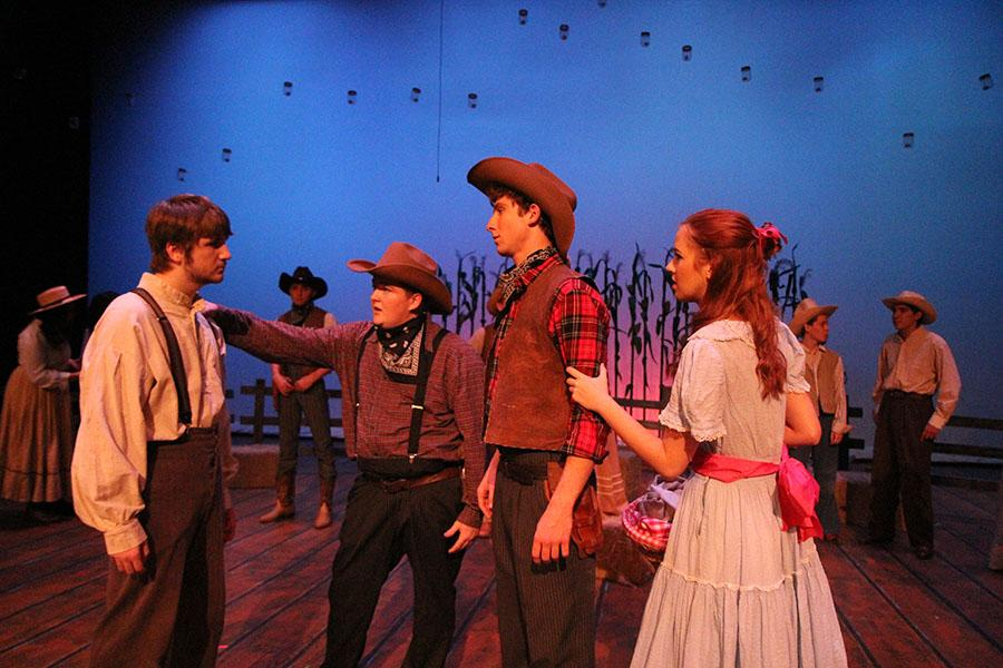Justin Schenzy (10), Jacob Wilkinson (11), Tim Nischbach (12), and Janna Schmid (12) rehearsing for Oklahoma!