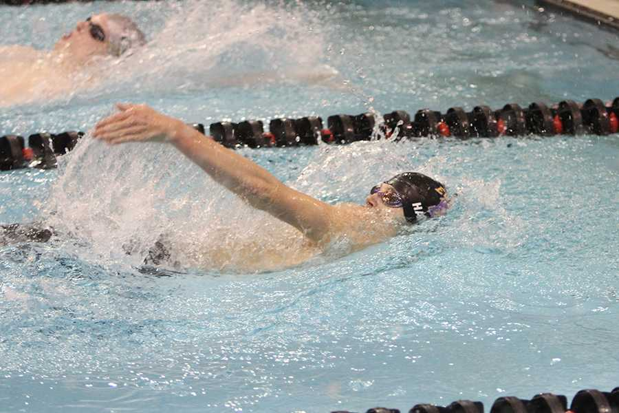 Brenden+Harris+nears+the+end+of+his+finals+run+in+the+100-yard+backstroke%2C+Nov.+8.