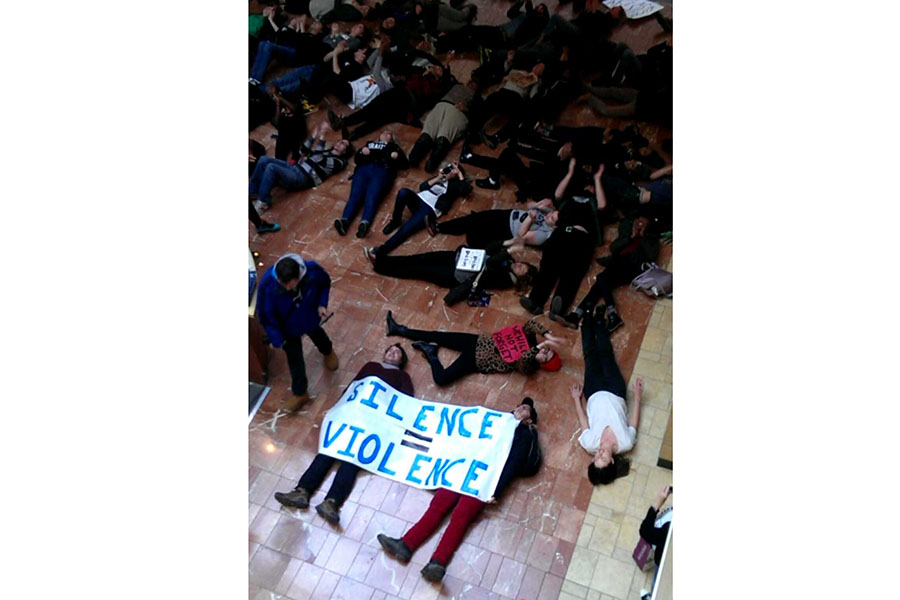 Protesters  in support of Mr. Michael Brown, shooting victim, laid down in the West County Mall on Black Friday for four minutes in representation of the four hours the Ferguson police left Mr. Brown lying dead after he was shot. Nov. 28.