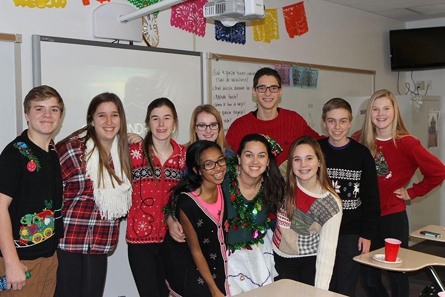 Miss+Julie+Wietzel%2C+Spanish+teacher%2C+and+her+fourth+hour+Spanish+two+students%2C+who+participated+in+holiday+sweater+day%2C+pose+for+a+picture%2C+Dec.+12.