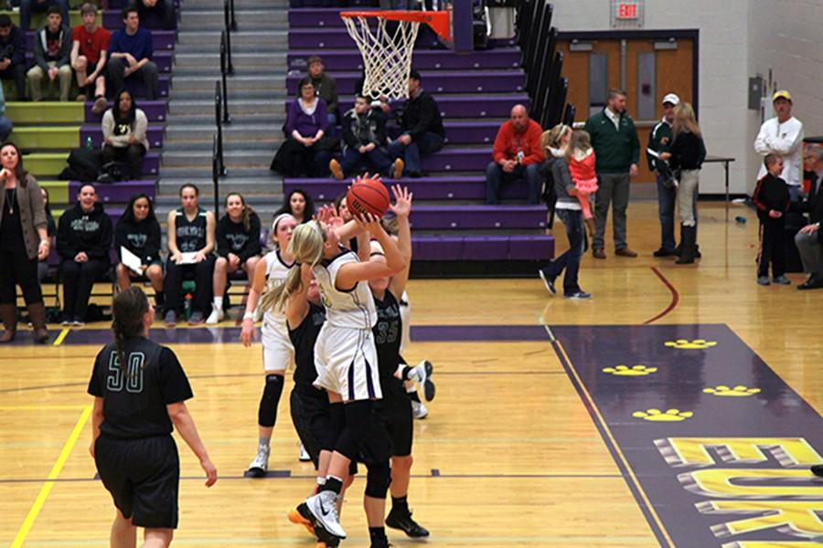 Grace Archambault, forward, goes up for the basket against Mehlville, Feb. 6.