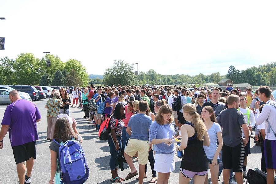 The evacuated faculty and student body on the south side of the building, Sept. 10.