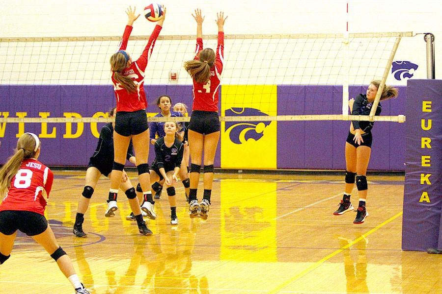 Cor Jesu goes up for block against Wildcats, Sept. 9.