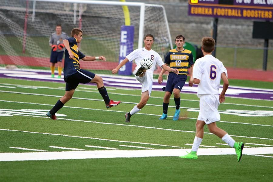 Jake Naeger kicks the ball toward the O'Fallon goal Friday September 18. 2015