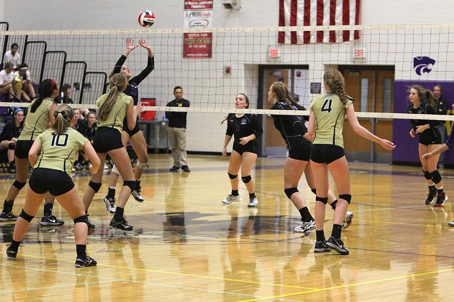 Varsity girls volleyball goes up for a block against Francis Howell North, Oct. 15.