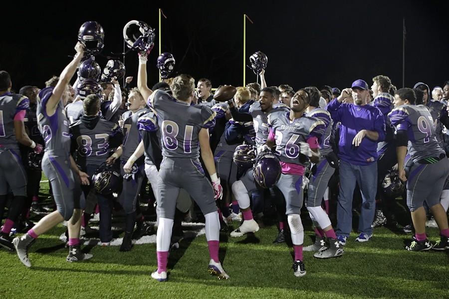 Varsity wildcats celebrate a second win in the playoffs against Marquette, Oct. 30.