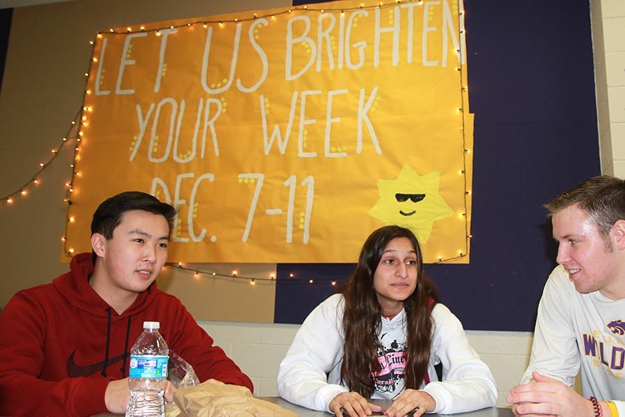 Nathan Cheung, Catimona Morris and Sean Markley (12)  chat during lunch, Dec. 12.