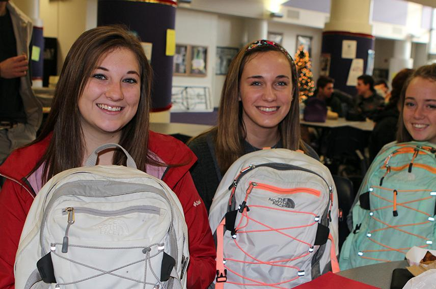 Alicia Pieper, Olivia Grayson and Cara Peterson (12) sit with their own personal backpacks at lunch.