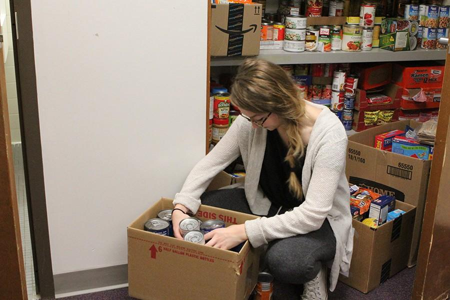 Maddie Rose Ortinau, officer, sorting cans in officer Mike Smith's office, Nov. 18.