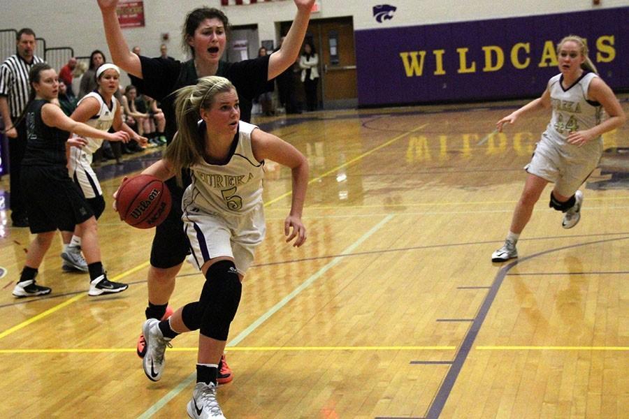 Grace Archambault,  varsity forward, carries the ball toward the net, Feb. 6, 2015.