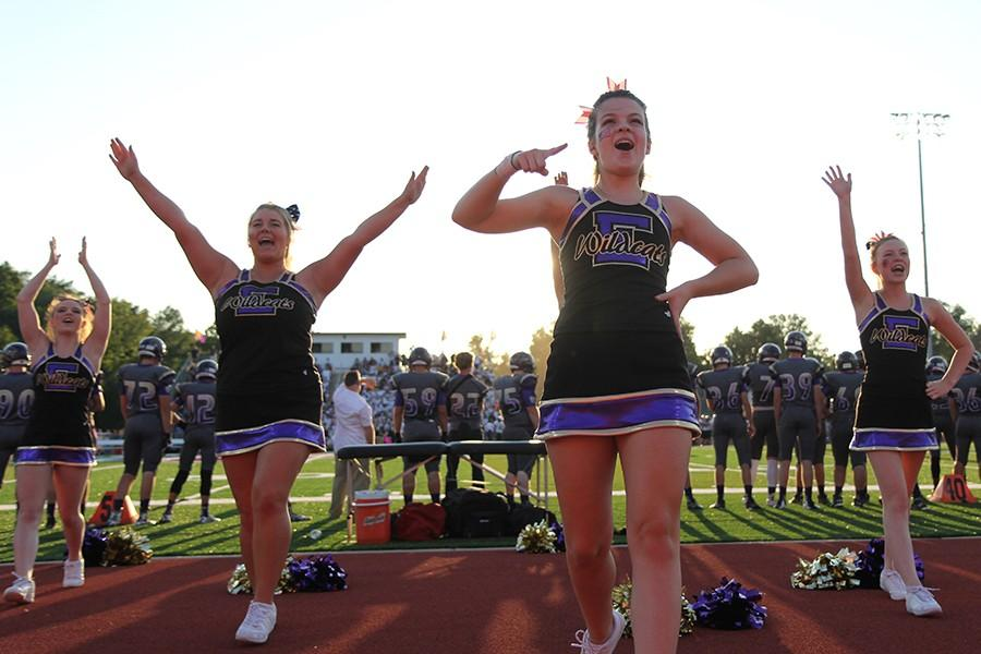 Shelby+Clay%3B+Angelina+Mitchell+and+Mary+Jo+Clancy%2C+varsity+cheer%2C+pump+up+the+crowd+at+the+varsity+football+game+against+Lafayette+High+School%2C+Aug.+21.