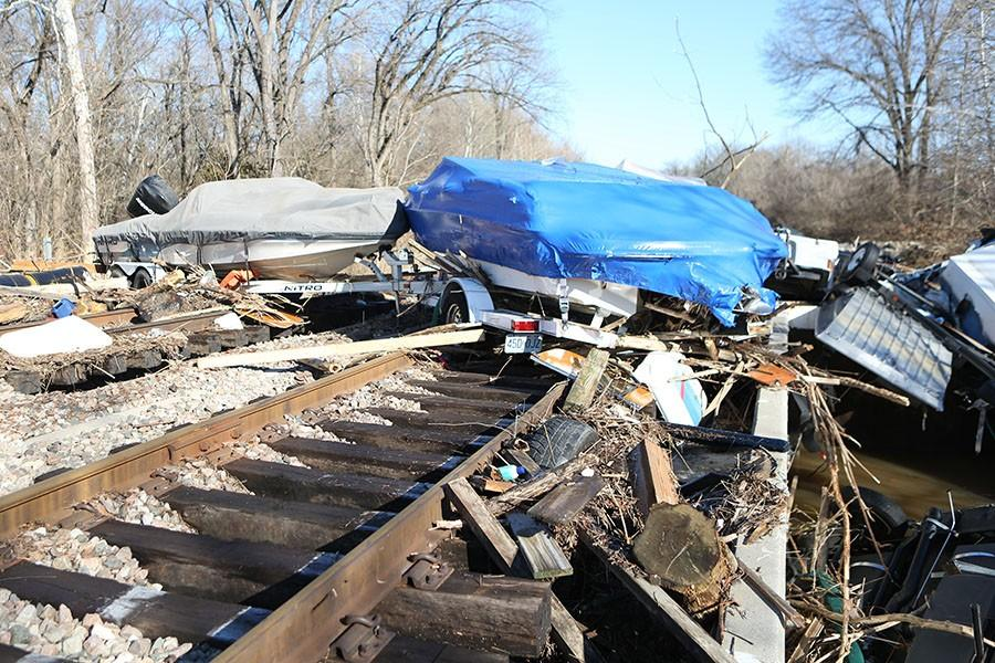 Boats block the railroad tracks after the historic flood, Jan. 1, 2016