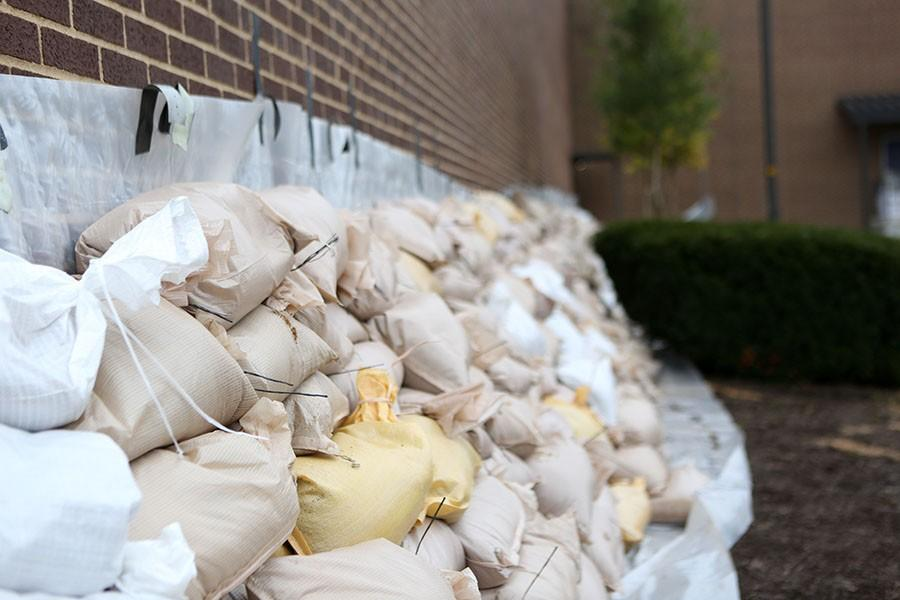 Sand+bags+placed+by+RSD+staff+earlier+that+day+against+the+athletic+building+to+help+prevent+the+presence+of+water+in+EHS%2C+Dec.+29.