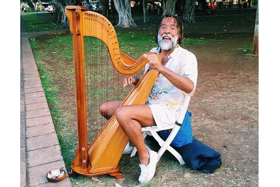 A man played his harp on the side of the street in Maui, March 15. I wish I would have gotten his name. That's my biggest regret.