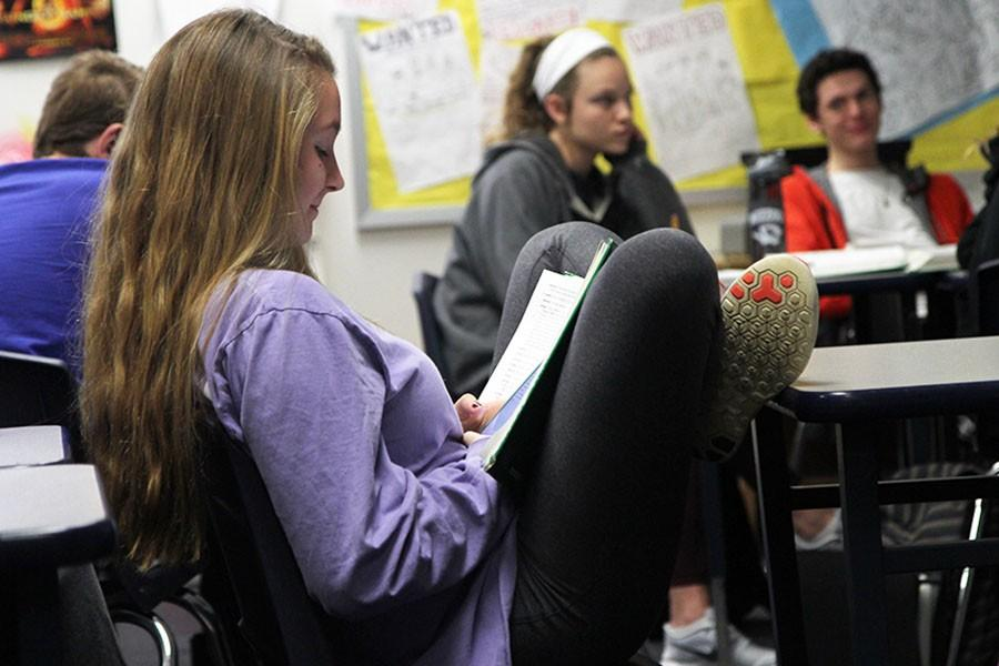 """Kylee Bowling (9) uses her phone during a lesson on Shakespeare in Mr. Keith Pardeck's 3rd hour Language Arts 9 Honors class, March 4. """"I took notes on my phone because I do not have a Language Arts notebook, but I definitely could have misused that privilege."""""""