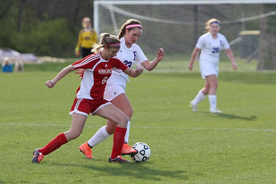 Rosina Fascetti, Girl's JV soccer, guards the ball against Kirkwood, April 1.