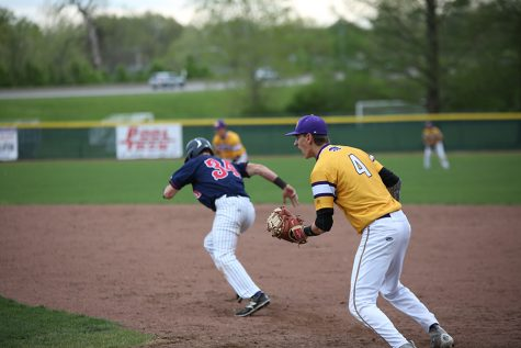 Zac Husman, first base, calls to his pitcher during the game against Parkway South, April 21.