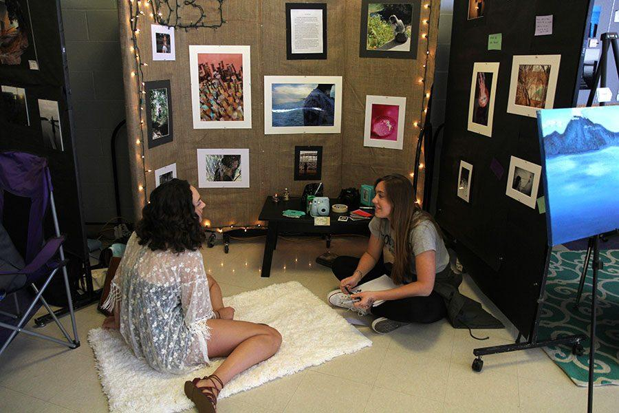 Abby Hudson (12) and Allison Alvey (12) show off their artwork at the school wide art show. April, 4