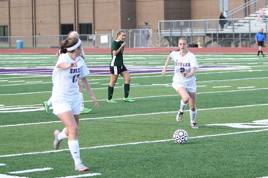 Sarah Clubb, varsity soccer, and Olivia Osterhage, varsity soccer, playing Melville, 4/19.