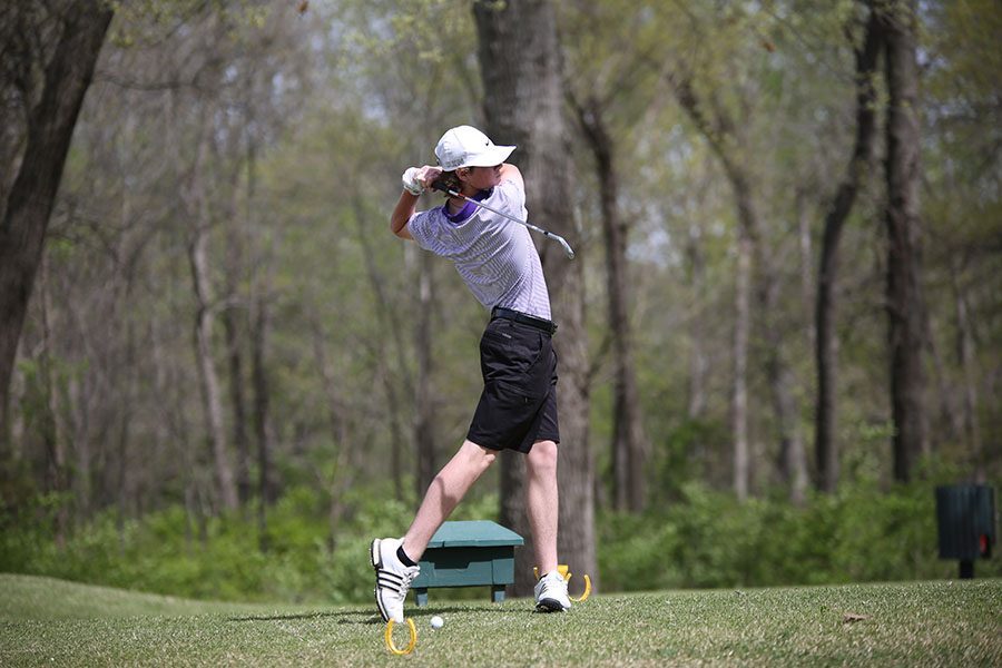 Evan Rief, varsity golf, taking a swing at the Webster Cup, 4/18.