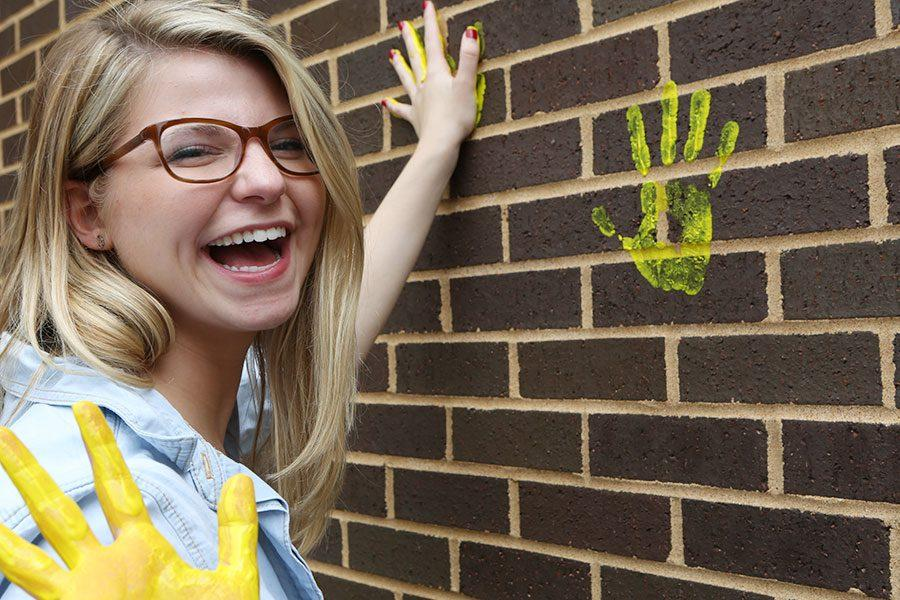 Lauren Rocca leaves her mark on the wall outside the EHS-hub, May 11.