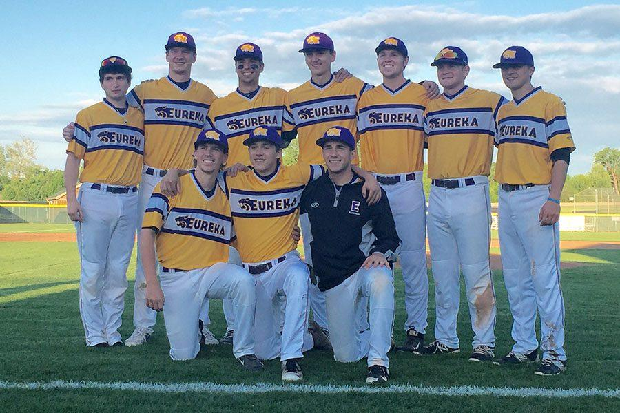 Varsity baseball seniors stand together for a picture, May 3.
