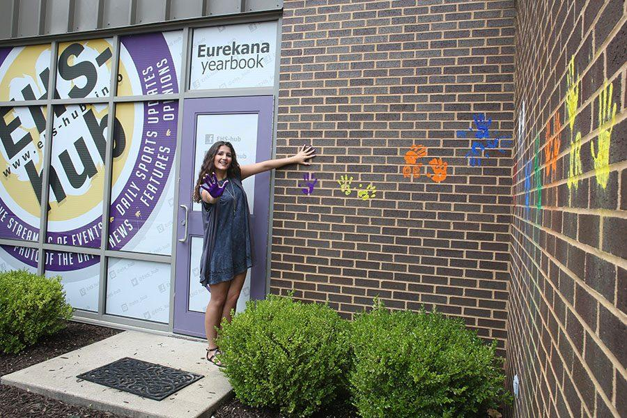 Mary Kay Gagnepain leaves her mark on the wall outside the EHS-hub, May 12.