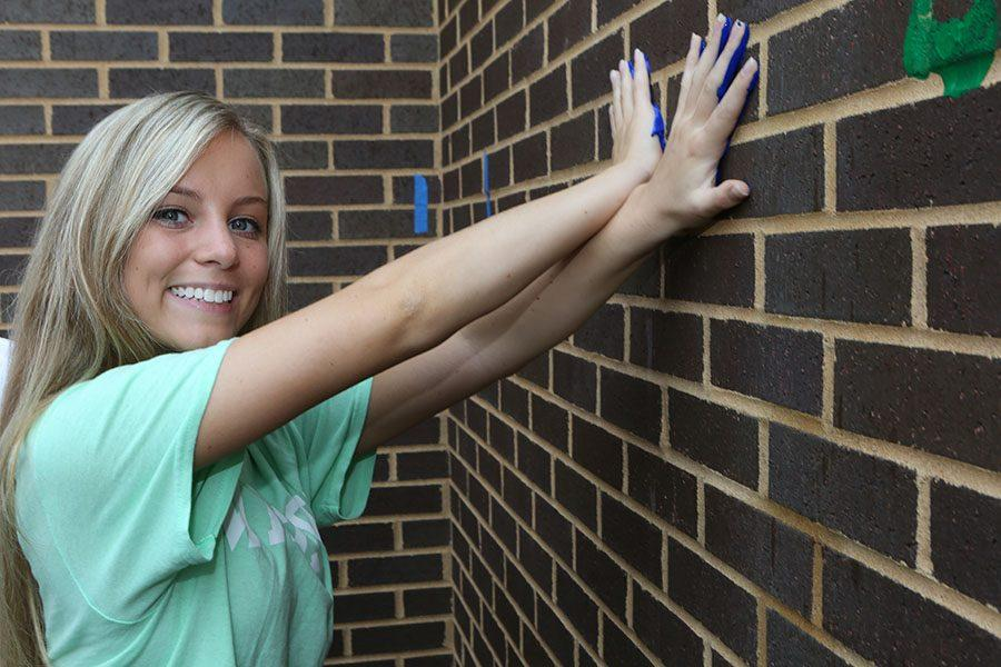 Maddy Roller leaves her mark on the wall outside the EHS-hub, May 11.
