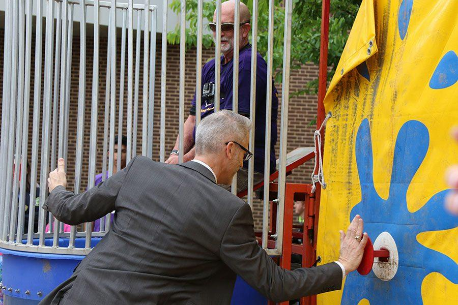 Dr. Erik Knost, Rockwood superintendent, dunks Mr. Charles Crouther, head principal, in the dunking booth, 4/29.