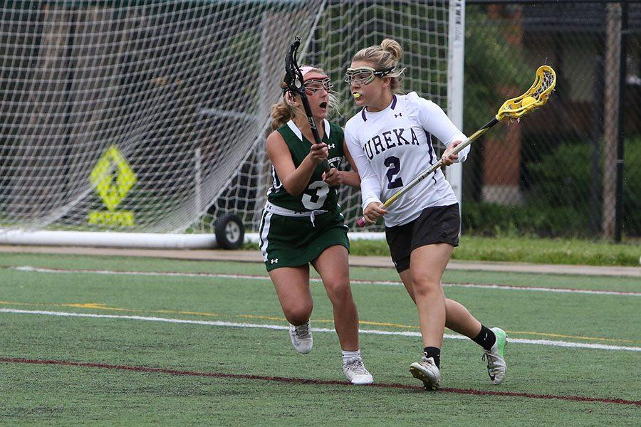 Julia De Beir (varsity lacrosse) facing off against Nerinx at districts, May 16.