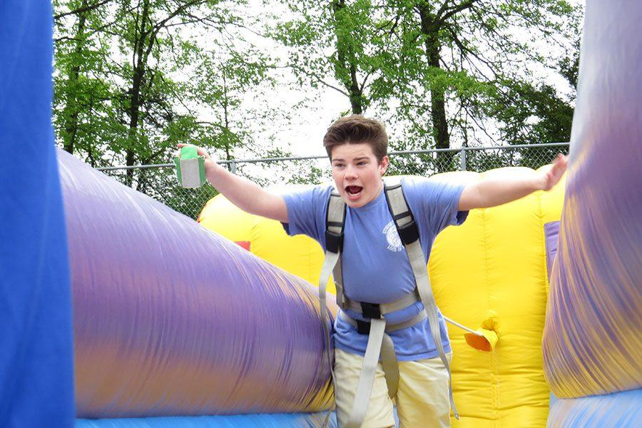Jerod Turner (10) races on a bouncy house, 4/29.