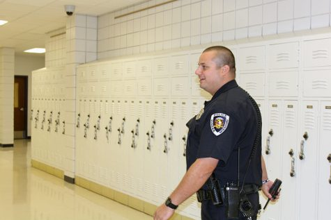 "Officer Brett Grittini, SRO, walks through the hallways of EHS, Aug. 16. Having worked for EPD, he enjoys furthering his connection to the community. ""I"